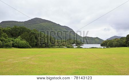 Green lawn in front of Muckross Lake.