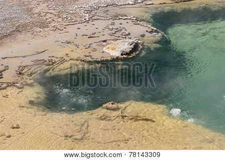 Bubbling Water In A Colorful Hot Spring