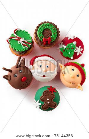 Colorful decorative Christmas cupcakes  over white