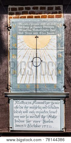 OSTERHEIDE GERMANY - APRIL 12 2014: famous old sun dial at the church in Osterheide Germany. A sundial is a device that tells the time of day by the position of the Sun.