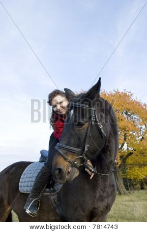 Two Smiles. Equestrienne And Horse.