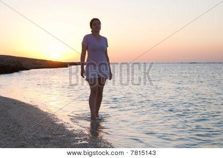 Girl At Sea Coast During  Sunrise