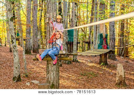 Little girls having fun in adventure park