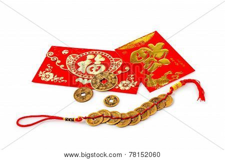 Red Gift Bags And Gold Ingots On White