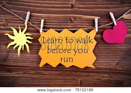 Orange Label With Life Quote Learn To Walk Before You Run