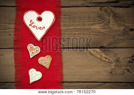 Red Fabric Texture With Heart Cookies