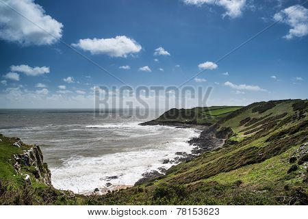 Summer Landscape Of Worm's Head And Rhosilli Bay In Wales