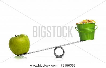 One green apple and a bucket of pills
