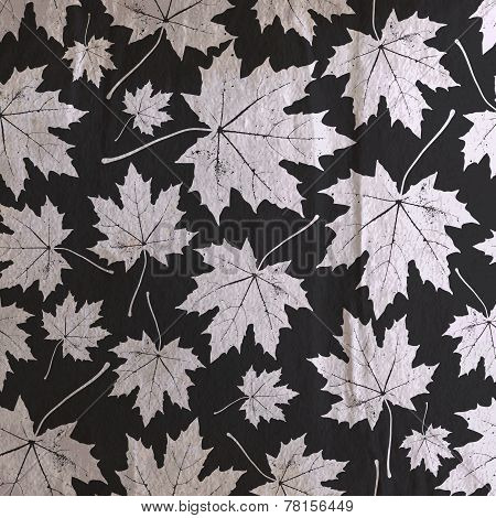 vintage floral background with maple leaves on the old wrinkled paper texture