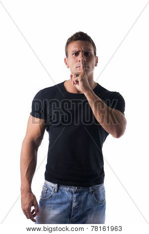 Young Man Doing Shut Up Sign With Finger On Lips