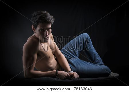 Handsome Muscular Shirtless Young Man Laying Down On The Floor