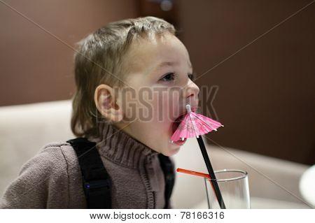 Child Biting Drinking Straw