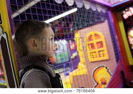 Kid In Amusement Park
