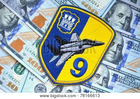 Kiev,Ukraine.Dec 14.Illustrative editorial.Chevron of Ukrainian military officer (air force). 9 Aviation brigade.With money background.At December,2014 in Kiev, Ukraine