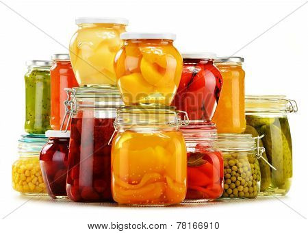Jars With Pickled Vegetables, Fruity Compotes And Jams Isolated