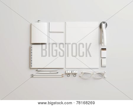 Set Of White Branding Elements On Paper Background