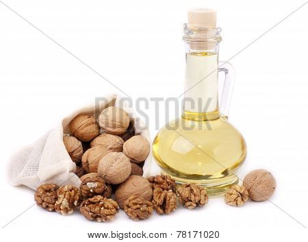 Walnut Oil And Walnuts On A White Background.