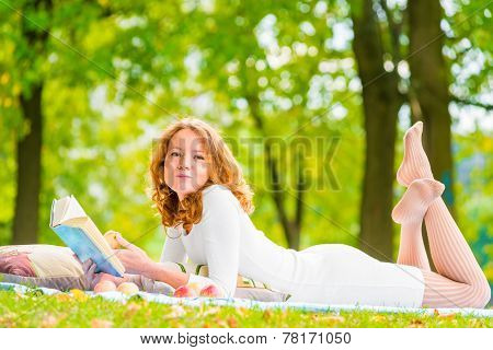 Romantic Girl With A Good Book And A Delicious Apple In The Park