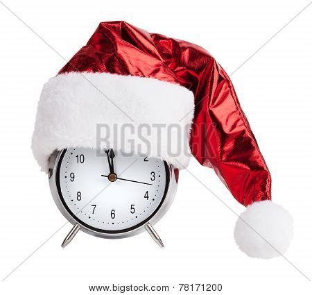 Santa Claus Cap On A Round Alarm Clock