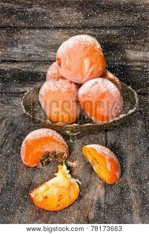 Persimmons Under The Snow