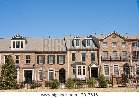 Brown Brick Townhouses Under Blue Sky