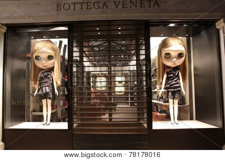 Bottega veneta window with doll at night