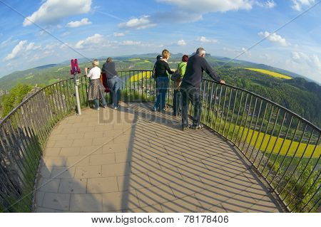 Unidentified tourists enjoy panoramic view, Rathen, Germany.
