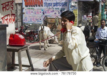 Unidentified man calls by red street shop phone on April 07, 2007 in Jodhpur, India.