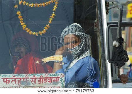 Unidentified passengers sit in the cabin of ready to depart intercity bus, Mandawa, India.