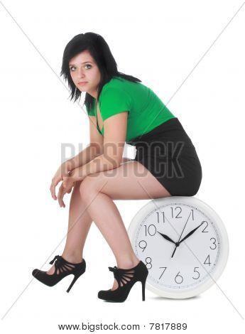 Woman Sitting On Clock