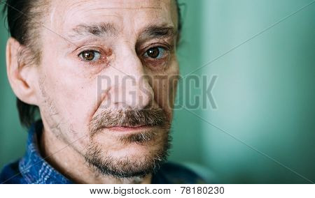 Portrait Of Serious Sad Old Adult Expressive Man With Beard Looking At Camera