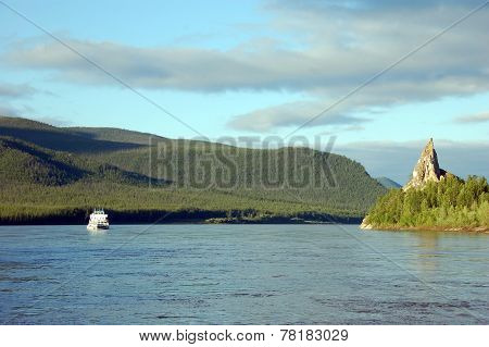 Cargo Ship And Rock At Kolyma River Russia