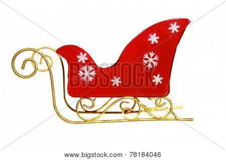 A Genuine Red Santa Claus Sleigh with Gold Trim and white Snow Flakes isolated on white with room for your text. Santa Claus uses his Sleigh and his Reindeer to fly around in the sky on Christmas eve