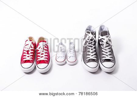 Shoes In Father Big, Mother Medium And Son Or Daughter Small Kid Size In Family Love Concept