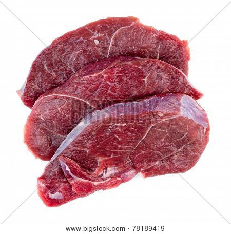Aerial Of Raw Red Meat Steaks Isolated Against A White Background