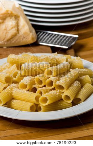 Italian Pasta With Oil And Cheese On Wooden Table
