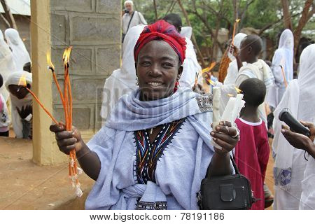 The Woman Prays With The Burning Candles In Hands.