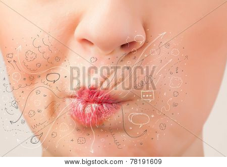Pretty woman mouth blowing hand drawn icons and symbols close up