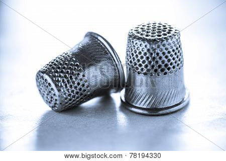 Two Metal Sewing Thimbles