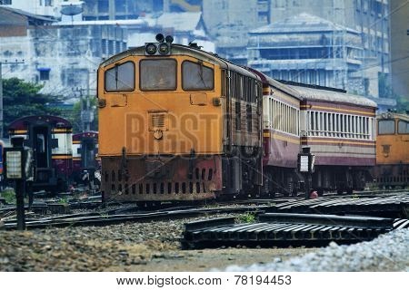 Front View Of Old Diesel Trains Running Junction Of Railroads Track Against Urban Land Transport Sce