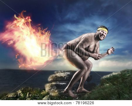 Bizarre naked man farts flame