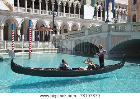 Unidentified people enjoy gondola ride at Grand Canal at The Venetian Resort Hotel Casino