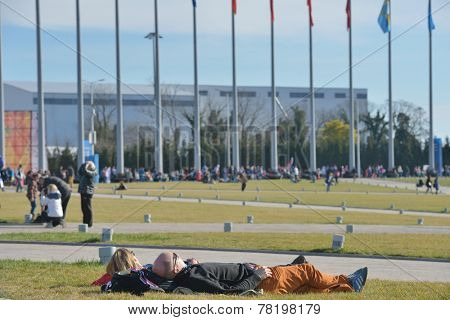 SOCHI, RUSSIA - FEBRUARY 12, 2014: People resting in the Olympic park during Winter Olympics. Russia hosted the second Olympics in history