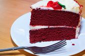 image of red velvet cake  - Red velvet cake and a fork on a white plate - JPG