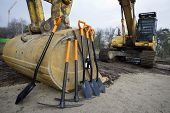 image of track-hoe  - Worker tools stand before starting groundbreaking ceremony - JPG