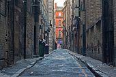 stock photo of derelict  - Looking down an empty inner city alleyway - JPG