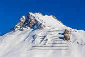 foto of avalanche  - Avalanche fences on top mountain - JPG
