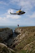 image of anglesey  - Search and Rescue Exercise on the Anglesey coastline of North Wales with a winchman learning how to help people in distress - JPG