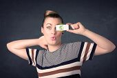 picture of gril  - Young girl holding paper with green dollar sign concept - JPG