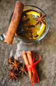 stock photo of christmas spices  - Christmas time cup of tea with cinnamon and anise spices festive decoration and candles - JPG